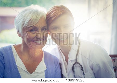 Portrait of smiling doctor and patient at home