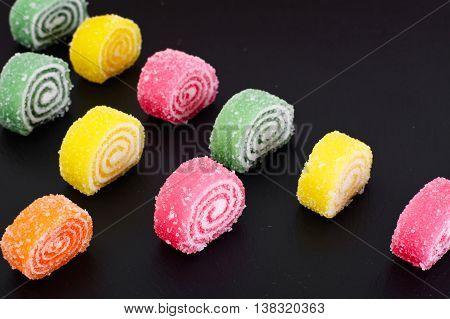 Sweet Candied Fruit Jelly on Dark Background Studio Photo