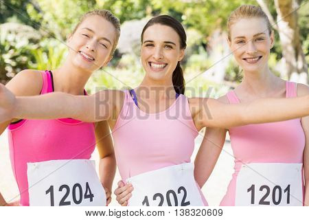 Portrait of young athlete women posing in park