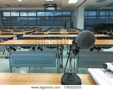 Empty lecture room with microphone in front
