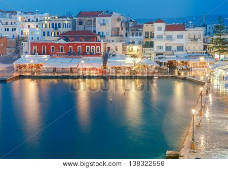 Night view of the embankment with lanterns in the old harbor in Chania. Crete. Greece.