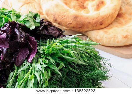 Pita bread with fresh dill, basil, coriander and tarragon