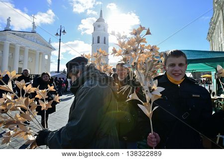 VILNIUS, LITHUANIA - MARCH 2: Unidentified people trades hand made wood flowers in annual traditional crafts fair - Kaziuko fair on Mar 2, 2013 in Vilnius, Lithuania