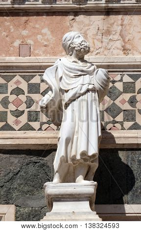 FLORENCE, ITALY - JUNE 05:  Statue of Prophet attributed to Andrea Pisano, Portal on the side-wall of Cattedrale di Santa Maria del Fiore, Florence, Italy on June 05, 2015