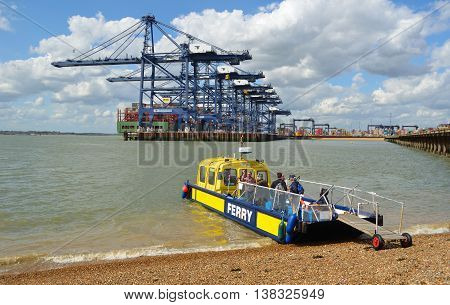 Felixstowe, Suffolk, England -  MAY 03, 2016: Harwich to Felixstowe and Shotley ferry takes up to twelve people across the busy estuary, port of Felixstowe in background.