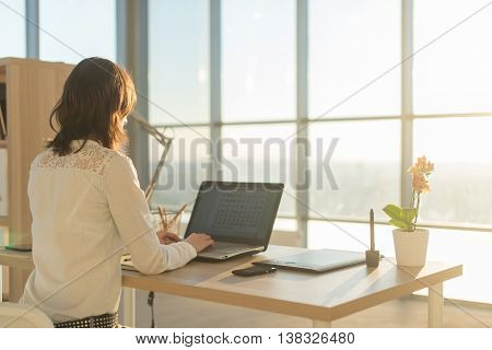 Woman using laptop at home woman's hands on notebook computer