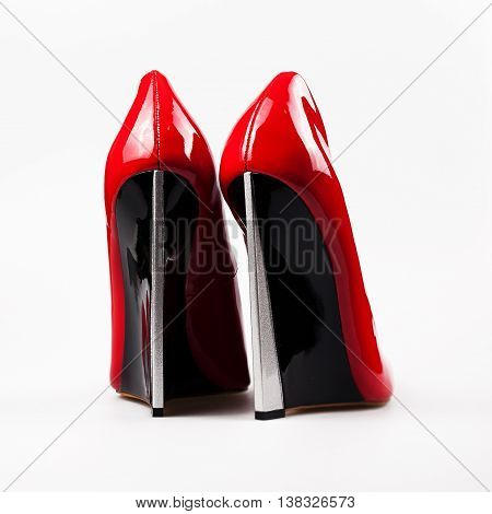 Red high heel shoes isolated on white background.Back view