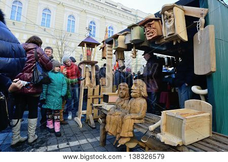 VILNIUS, LITHUANIA - MARCH 2: Unidentified people trades wooden dolls in annual traditional crafts fair - Kaziuko fair on Mar 2, 2013 in Vilnius, Lithuania