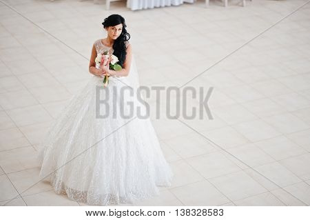 Temptation Model Brunette Bride At Exciting Wedding Dress With Wedding Bouquet At Hands Background B