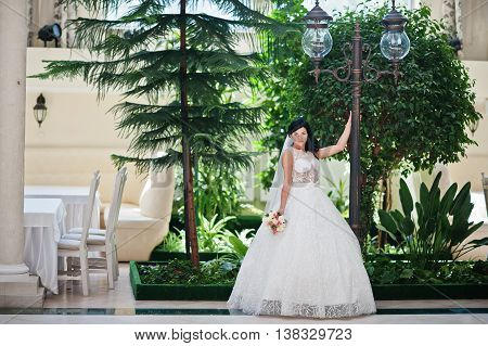 Temptation Model Brunette Bride At Exciting Wedding Dress Posed Near Lantern At Wedding Hall
