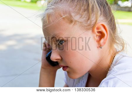 Photo of cute girl talking by cellular