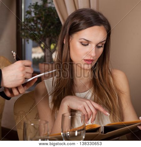 Woman Ordering A Meal