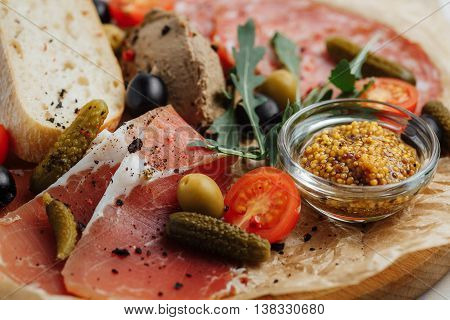 Meat With Pickles, Fresh Tomatoes, Olives And Mustard On A Wooden Tray