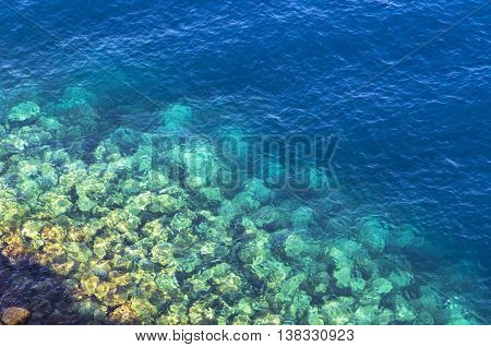 Background made of clear azure and blue sea water. View from above