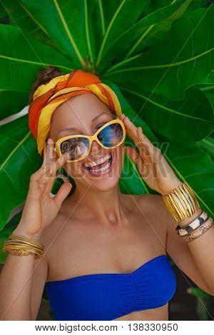 Happy summer girl in turban portrait outdoors