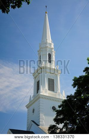 The First Church of Christ Congregational white steeple rising above buildings in West Hartford Connecticut.
