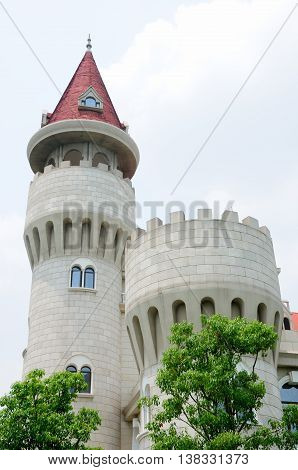 The watch tower at the european designed castle building Lake Malaren Birthcenter hospital in Baoshan district of Shanghai China.
