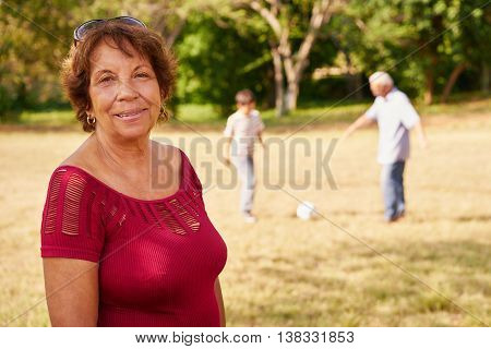 Happy Senior Grandma Playing Soccer With Family