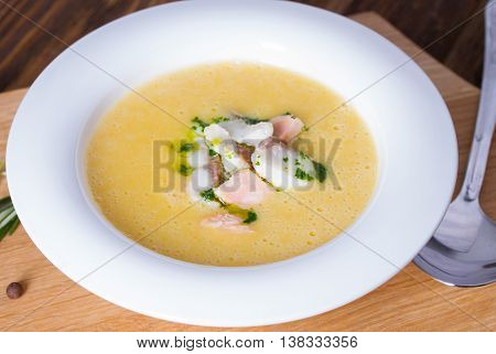 Cheese soup with smoked bacon and green onion