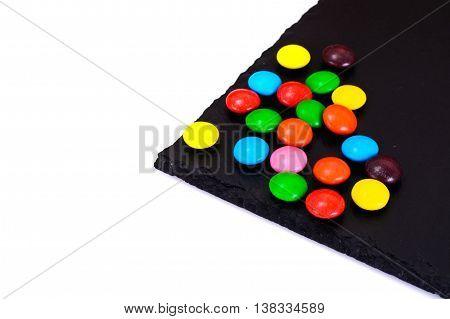 Sweet Bonbons Candy on Dark Background Studio Photo