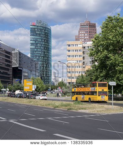 BERLIN GERMANY - JULY 7 2016: Sightseeing bus in front of the towers at Potsdamer Platz in Berlin Germany