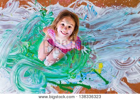 Creative Little Girl Having Fun With Paint