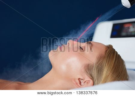 Localized Cryotherapy On Woman Face