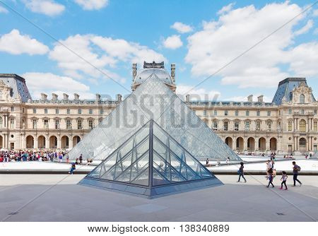 PARIS- JULY 9 : The Louvre Art Museum at sunny summer day on July 9, 2015 in Paris France