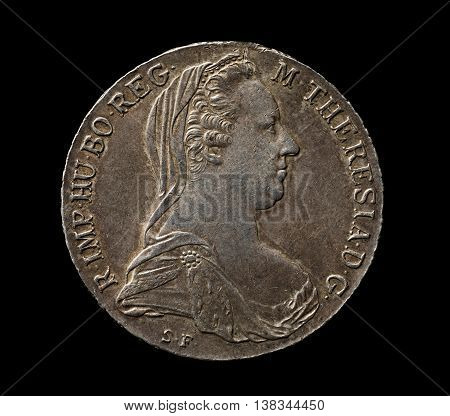 Maria Theresa silver thaler isolated on black closeup top view
