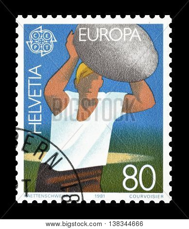 SWITZERLAND - CIRCA 1981 : Cancelled postage stamp printed by Switzerland, that shows Man throwing stone.