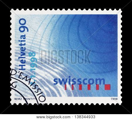 SWITZERLAND - CIRCA 1998 : Cancelled postage stamp printed by Switzerland, that shows Radio waves and logo of Swisscom.