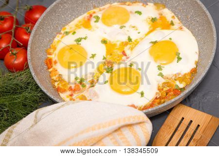 Shakshuka - traditional dish of israeli cuisine in a skillet pan