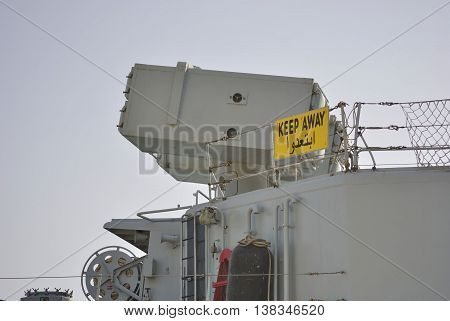 Weapon system on military ship with sigh Keep out.