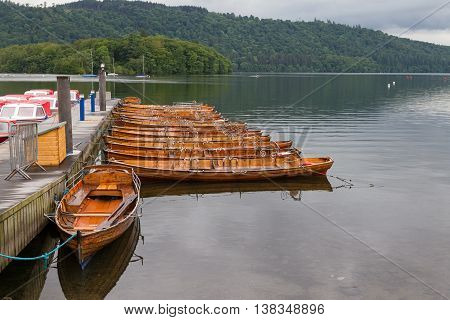 Pier And Moored Rwoing Boats In Bowness-on-windermere, Uk