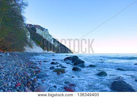 Blue Sea And Sky, Waves Break Off Stony Shore. Moment Before Sunrise