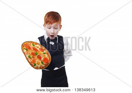 Clumsy little waiter drops tray serving pizza, food falling down. Redhead child boy in suit shows inattentive waiter failure at white background