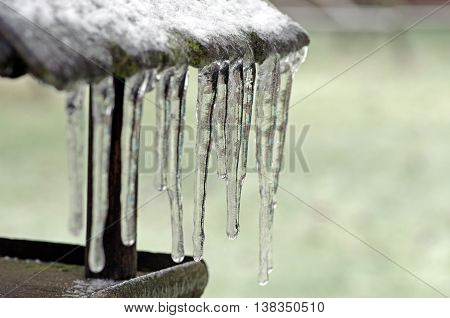 Birdhouse with icicles on a gray background