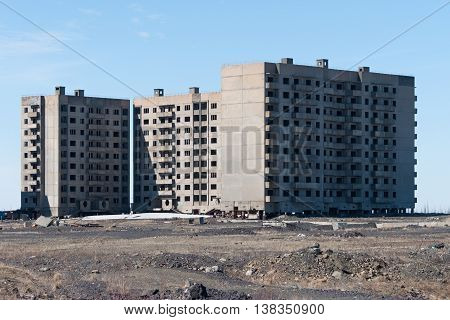 Derelict high-rise building in Norilsk. House on pile foundation, built on permafrost.