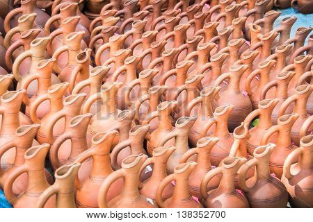 Many handmade old clay pots on perspective