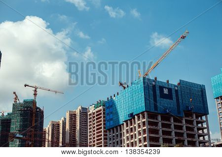 Unfinished houses on a background of clear sky.