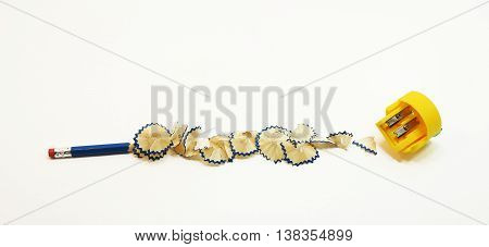 Small black pencil with shavings. Isolated on white background.