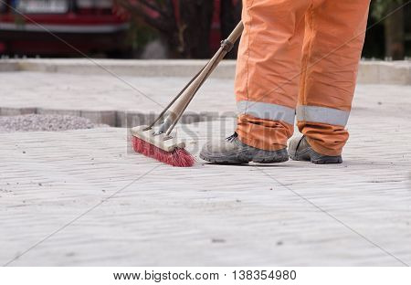 Construction Worker Sweeping