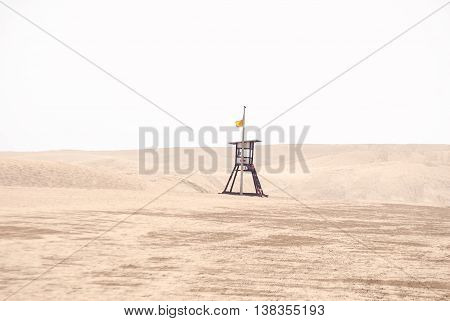 A shot of a lifeguard in the beach and nature reserve Dunes of Maspalomas in Grand Canary island