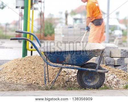 Construction Wheelbarrow At Building Site
