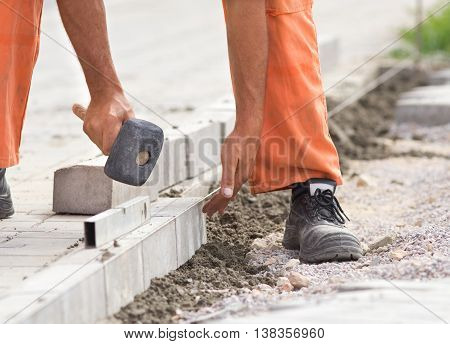 Worker Instaling Roadside Blocks