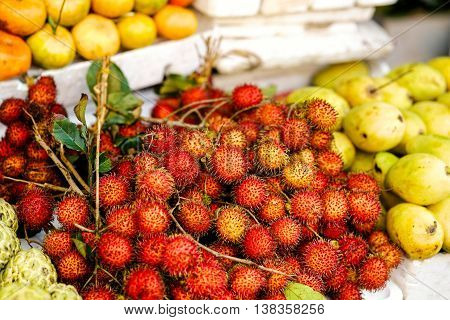 Asian Street Farmer Market Selling Riped Rambutan In Vietnam