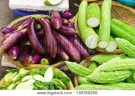 Asian Street Market Selling Egg Plant Zucchini And Bitter Melon