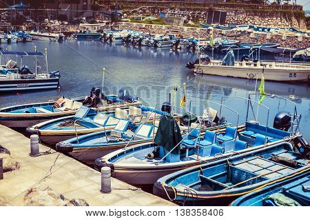 Boats on a beautiful smooth water at the berth.