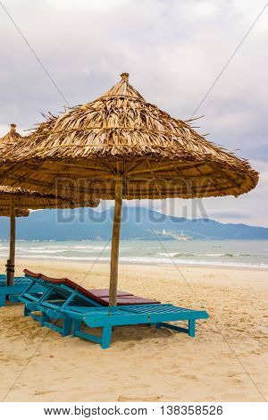 Palm Shelter And Sunbeds At China Beach In Da Nang