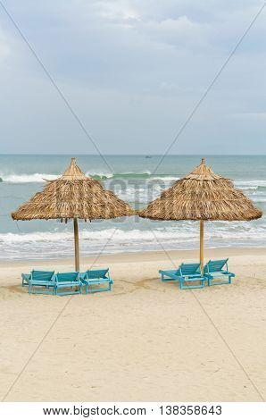 Palm Shelters And Sun Beds In China Beach In Da Nang